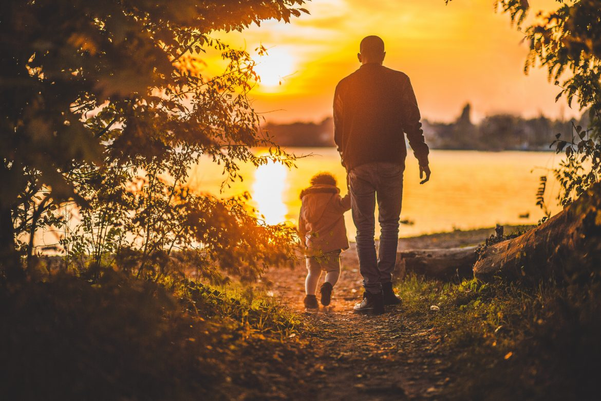 Man walks child alone.  Rafan House supports parents in the co-parenting challenges experienced over the holiday period.